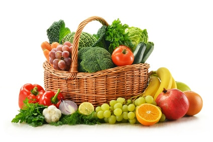 Composition with vegetables and fruits in wicker basket isolated